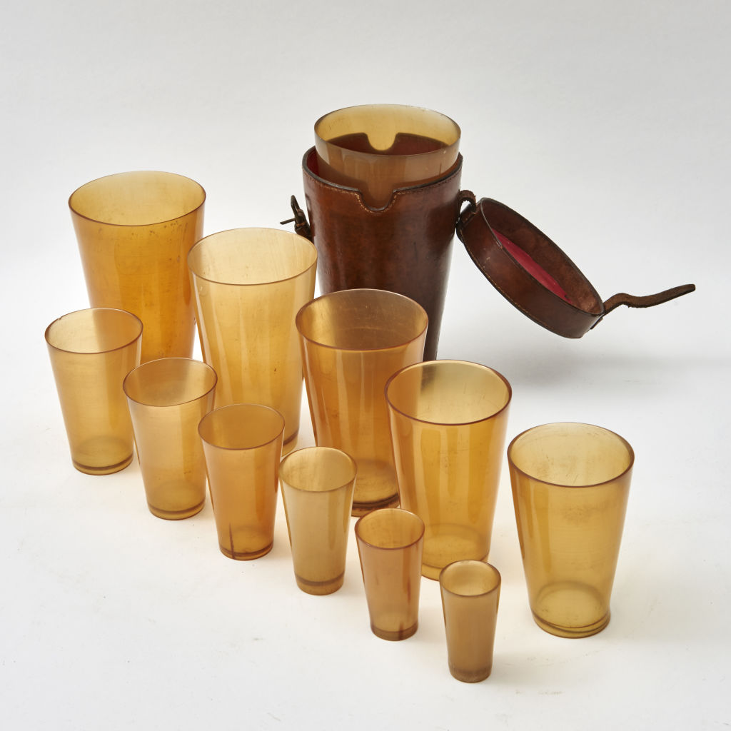 Twelve Graduated Horn Beakers