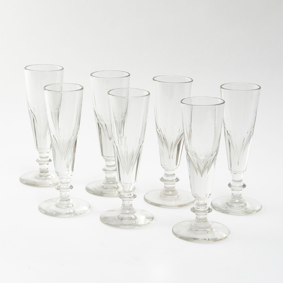 Seven English Crystal Champagne Flutes