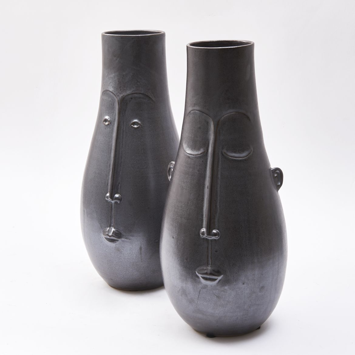Pair Pottery 'Face' Vases