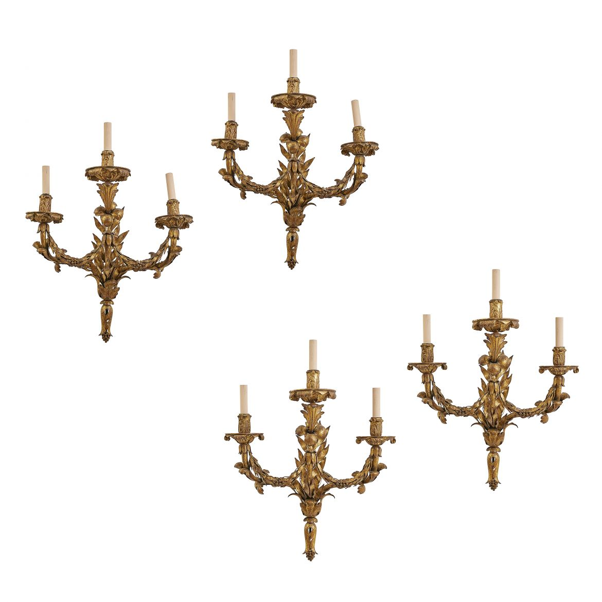 Four French Gilt Metal And Giltwood Sconces