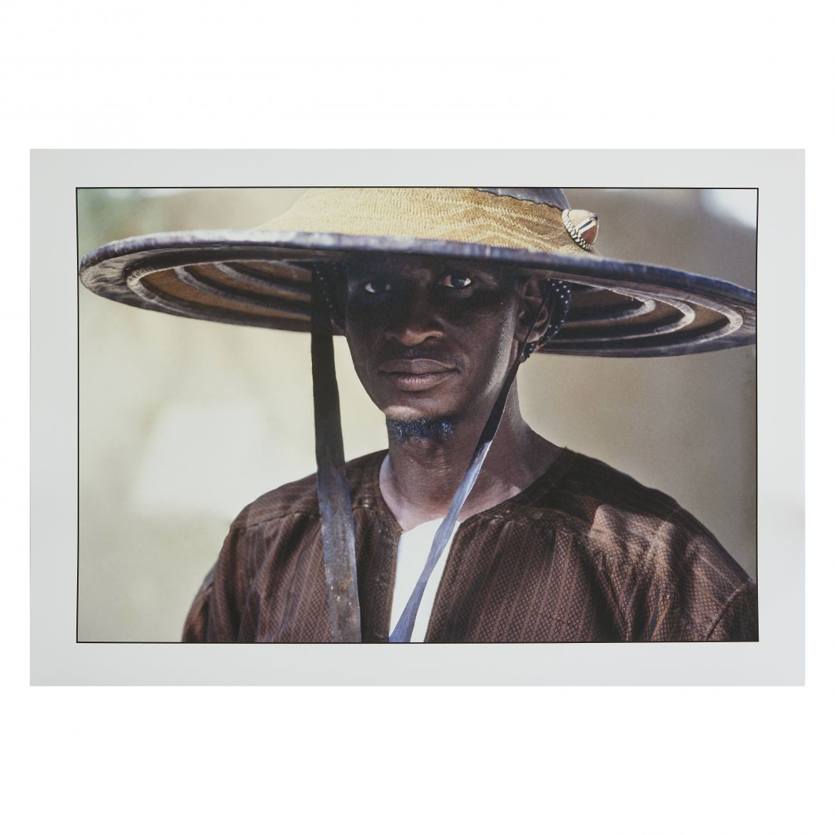 Man Wearing a Fulani Straw Hat