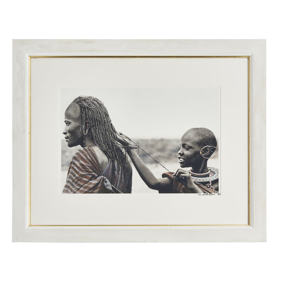 Young Maasai girl measuring her warriors Hair