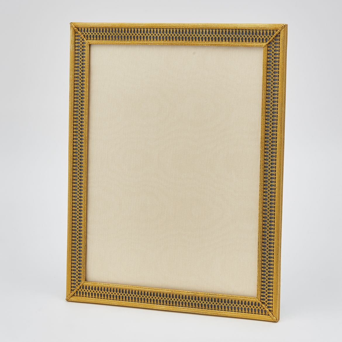 Gilt Bronze Frame With A Filigree Border