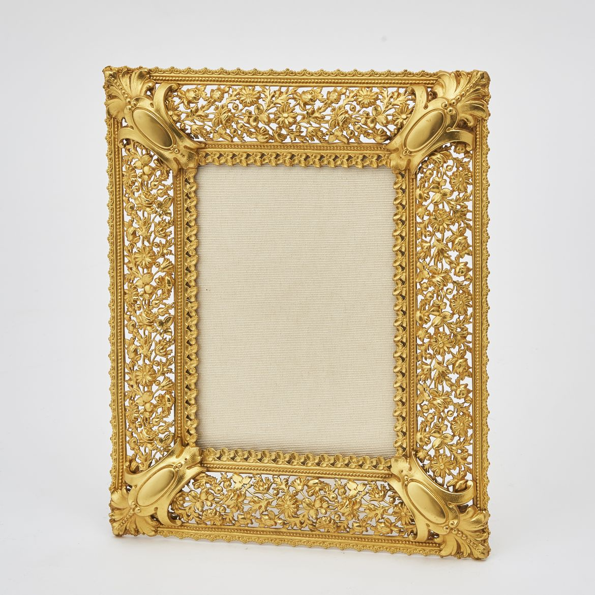 Pressed Gilt Bronze Frame With Corner Motifs